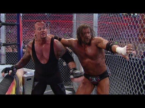 wrestlemania XXVIII - Triple H tries to break The Undertaker's WrestleMania winning streak in a Hell in a Cell match.