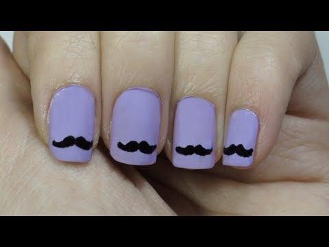 Uñas con bigotes o moustache nails