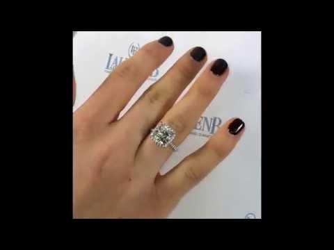 4 carat Cushion cut Diamond in sample Halo Setting