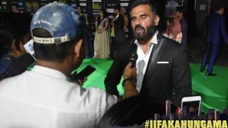 At the green carpet of IIFA New York, Bollywood Hungama spoke to Suniel Shetty.  He had a lot of positive things to say about daughter Athiya Shetty and said that he is looking forward to her upcoming film Mubarakan. Must Watch!Report: Faridoon ShahryarVideo Courtesy: Farrukh JilaniWatch more Exclusive Celebrity Interviews right here http://www.bollywoodhungama.com/Like BollywoodHungama on Facebook:https://www.facebook.com/bollywoodhungamacomFollow BollywoodHungama on Twitter:https://twitter.com/BollyhungamaCircle BollywoodHungama on G+:http://bit.ly/1uV6Qba