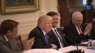 President Donald Trump listens to Sherrill Manufacturing CEO Greg Owens explain at the White House why his company is...