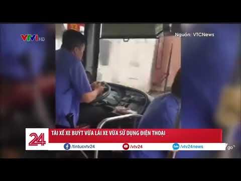 Vừa lái xe buýt vừa sử dụng điện thoại để nhắn tin và đọc báo @ vcloz.com