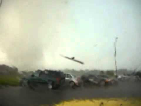 Tornado passes by a man in a car on his cell…