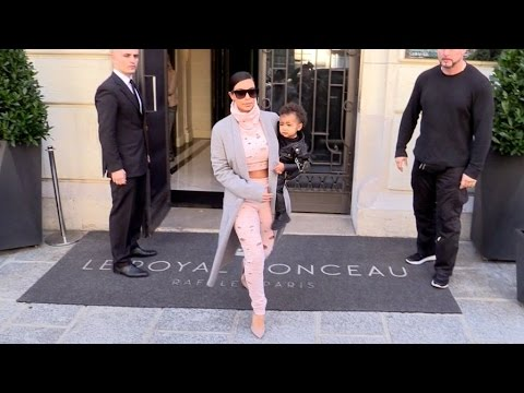 North - EXCLUSIVE - Kim Kardashian and North West leaving their hotel on tjeir way to the aiport EXCLUSIVE - Kim Kardashian wearing a Pink
