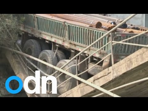 bridge - A truck has caused a small bridge to collapse in east China's Zhejiang Province. Report by Sophie Foster.