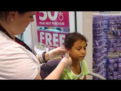 pierced - After lots of begging, Julia finally got to get her ears pierced.