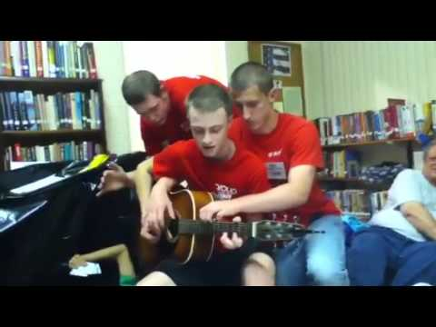 3 guys 1 guitar - 3 lonely men playing with each other.