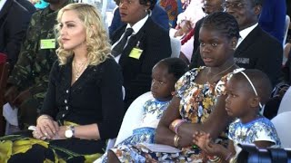 US pop superstar Madonna takes her four adopted Malawian children to the opening of a paediatric hospital wing that her charity has built in their home country.