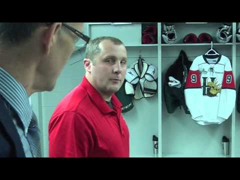 game tour - Halifax Mooseheads equipment trainer Chris MacDonald gives John Moore a tour of the team's room prior to their game with the London Knights at the 2013 Maste...