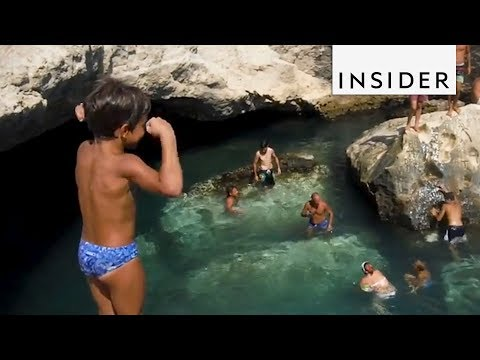 Cliff Jumping Into an Italian Grotto