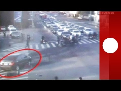 Dramatic video: China woman run over by car, rescued by passers-by