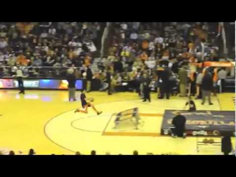 Kid Dunks Basket Ball and Himself