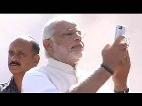 Narendra Modi takes a selfie after voting in Ahmedabad