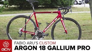 Lasty checks out the Argon 18 Gallium Pro Bike belonging to Grand Tour specialist Fabio Aru of the Astana Pro TeamSubscribe to GCN: http://gcn.eu/SubscribeToGCNGet exclusive GCN gear in the GCN shop! http://gcn.eu/hkWhat do you think of this Aru's bike? Let us know in the comments below 👇Here is the full spec of the bike belonging to the winner of the 2015 Vuelta a Espana.Frame and forks: Argon 18 Gallium Pro Wheels: Corima s32 tubularTyres: Schwalbe Pro1 HTHandlebars: FSA K-ForceStem: FSASeatpost: FSA K-ForceSaddle: Prologo Nago Evo Nack carbon railsShifters: Shimano Dura-Ace Di2 9070Brakes: Shimano Dura-Ace 9100Front Mech: Shimano Dura-Ace Di2 9070Rear Mech: Shimano Dura-Ace Di2 9070Chainset: FSA K-Force LightPedals: Look Keo BladeChainring size: 39/53Powermeter: Power2MaxCassette: Shimano Ultegra 11/28Bike weight: 6.88kgSaddle height: 77cmReach: 54.5cmBar width: 42cmStem length: 11cmCrank length: 172.5mmTyre width: 24.6mmFinishing touches: Custom paint, Prologo bartape, Tacx carbon bottle cagesIf you'd like to contribute captions and video info in your language, here's the link 👍  http://gcn.eu/hlWatch more on GCN...2017 Tour de France Playlist 📹  http://gcn.eu/hmGCN's Pro Bikes – Every Pro Bike Video On GCN Ever... 📹  http://gcn.eu/hnPhotos: © Bettiniphoto / http://www.bettiniphoto.net/ & ©Tim De Waele / http://www.tdwsport.comAbout GCN:The Global Cycling Network puts you in the centre of the action: from the iconic climbs of Alpe D'Huez and Mont Ventoux to the cobbles of Flanders, everywhere there is road or pavé, world-class racing and pro riders, we will be there bringing you action, analysis and unparalleled access every week, every month, and every year. We show you how to be a better cyclist with our bike maintenance videos, tips for improving your cycling, cycling top tens, and not forgetting the weekly GCN Show. Join us on YouTube's biggest and best cycling channel to get closer to the action and improve your riding!Welcome to the Global Cycling Network 