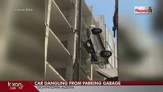 Video SUV dangles from downtown Austin parking garage after driver drives off the top floor MP3, 3GP, MP4, WEBM, AVI, FLV Oktober 2017