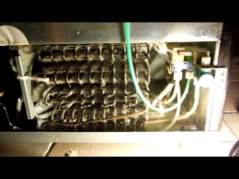 Residential Refrigerator. Showing-How to Clean the Condenser.
