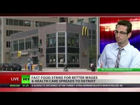 RT America - More than 400 workers at over 60 fast food restaurants in Detroit, Michigan walked off the job demanding $15 an hour -- far more than the state's $7.40 an ho...