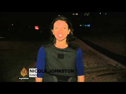 live - Loud shelling cuts short the live report of Al Jazeera's Nicole Johnston as she seeks shelter in Gaza.