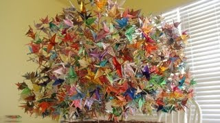 A sequence of photos showing how a wired tree hanging 1000 origami folded paper cranes is made.   The construction took 6 months.  NOTE: this is not an instructional film, purely for entertainment -- if you want it to be instructional, you can pause at every photo.  The movie consists of 750 photos compressed into 4-minute film at a rate of 3 frames per second.