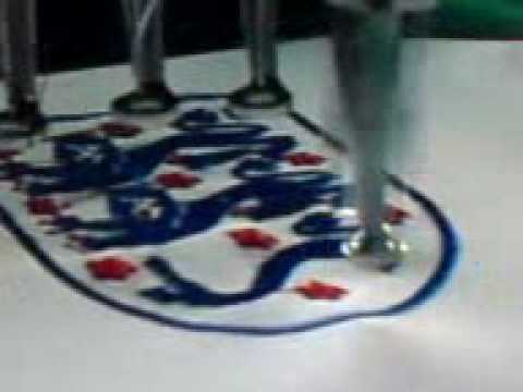 Making or embroidery the England crest