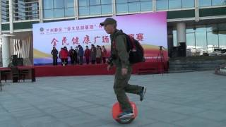 Old Man One Leg Stands Riding Electric Unicycle