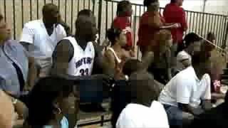 Shaq and his wife watching their son Shareef