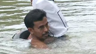 Teacher Swimming To Work in India