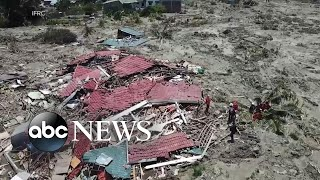 Video More than 1,400 dead, thousands injured after Indonesia quake MP3, 3GP, MP4, WEBM, AVI, FLV Desember 2018