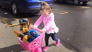 Cute little girl pushing Paw Patrol chase pup in her pink stroller and shopping at Toys R Us. Having fun trying out power wheels cars, bicycles, looking at surprise eggs, PJ Masks art play set, Fisher-Price and Little People, Little Tikes toys, Minnie Mouse couch, Paw Patrol couch, and lots more toys!Come along and shop with us!