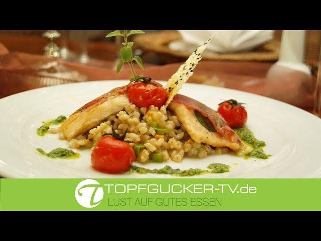 Gebratenes Saiblingsfilet mit Copa an Kräuterpesto und Gemüse-Graupenrisotto
