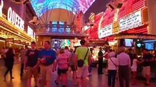Take a walk through downtown Las Vegas's famous Fremont Street. This video was recorded on Saturday April 12, 2014.The downtown area of Las Vegas is about a ...
