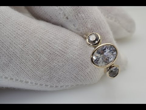 A gold bezel ring with 3 fine quality white sapphires 2168