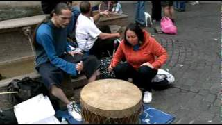Mother And Son Sioux Ojibwa Native Americans Drumming And Singing Downtown In Portland Oregon Big Drum. Summer July 3rd 2011.