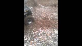 10. Polaris Sportsman 700 getting winched out of soft creek
