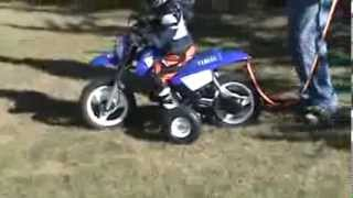 9. Nicholas first ride Yamaha PW50 throttle limited with Training Wheels