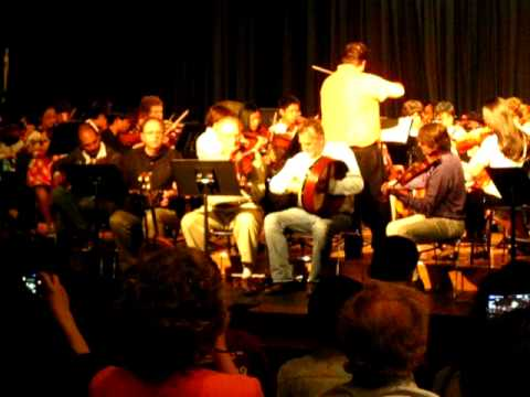 Traonach plays slip jigs with DeWitt Middle School Orchestra