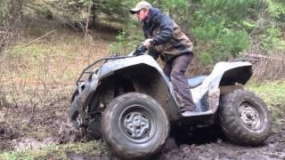 5. 2006 Brute Force 750 4x4i diff lock in mud