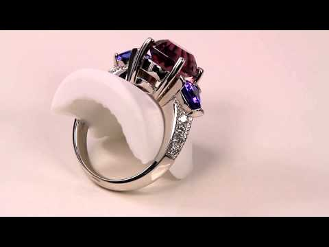 Gem quality Rhodolite Garnet Accented by Trilliant Tanzanites and Fine Diamond