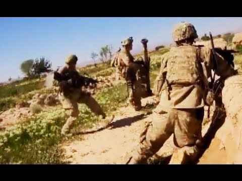 gunner - A M249 machine gunner runs directly towards a hail of Taliban PKM machine gun fire and RPGs, laying down suppressing fire once he makes it to cover. From the cameraman: This is a short video...