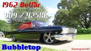 Here's a customized early American Muscle Car, a sweet Bubbletop 409 425 horspower dual 4bbl 4-speed 1962 Chevy BelAir in a quick video tour at my client's ranch. This car features a professionally built 409 with roller rockers, a Comp Cam, Dual Edelbrock 4bbl. carburetors & a Muncie 4-speed manual transmission. It rides on 18 and 20 inch wheels with air ride suspension. This is a perfect Hot Rod power tour or Saturday Night Cruiser. Tuxedo Black with Torch Red Ultra Leather Interior, Tilt Steering, updated Power Steering Pump. Filmed by Samspace81. Follow me on Facebook and YouTube for classic cars, custom cars, antique cars, collector cars, exotic, musclecars and more. Retro Road Tests test drives, you'll get it here. This is not an Impala, but a rare Bubbletop Bel Air Kruiser