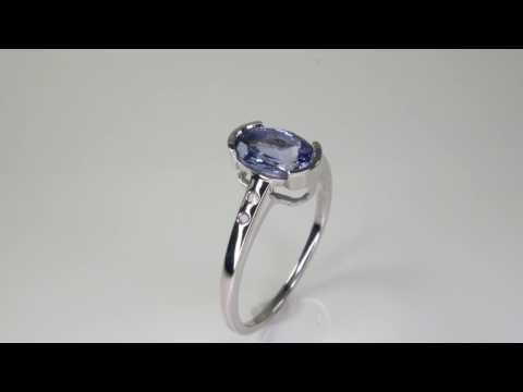 tanzanite bezel set oval white gold ring