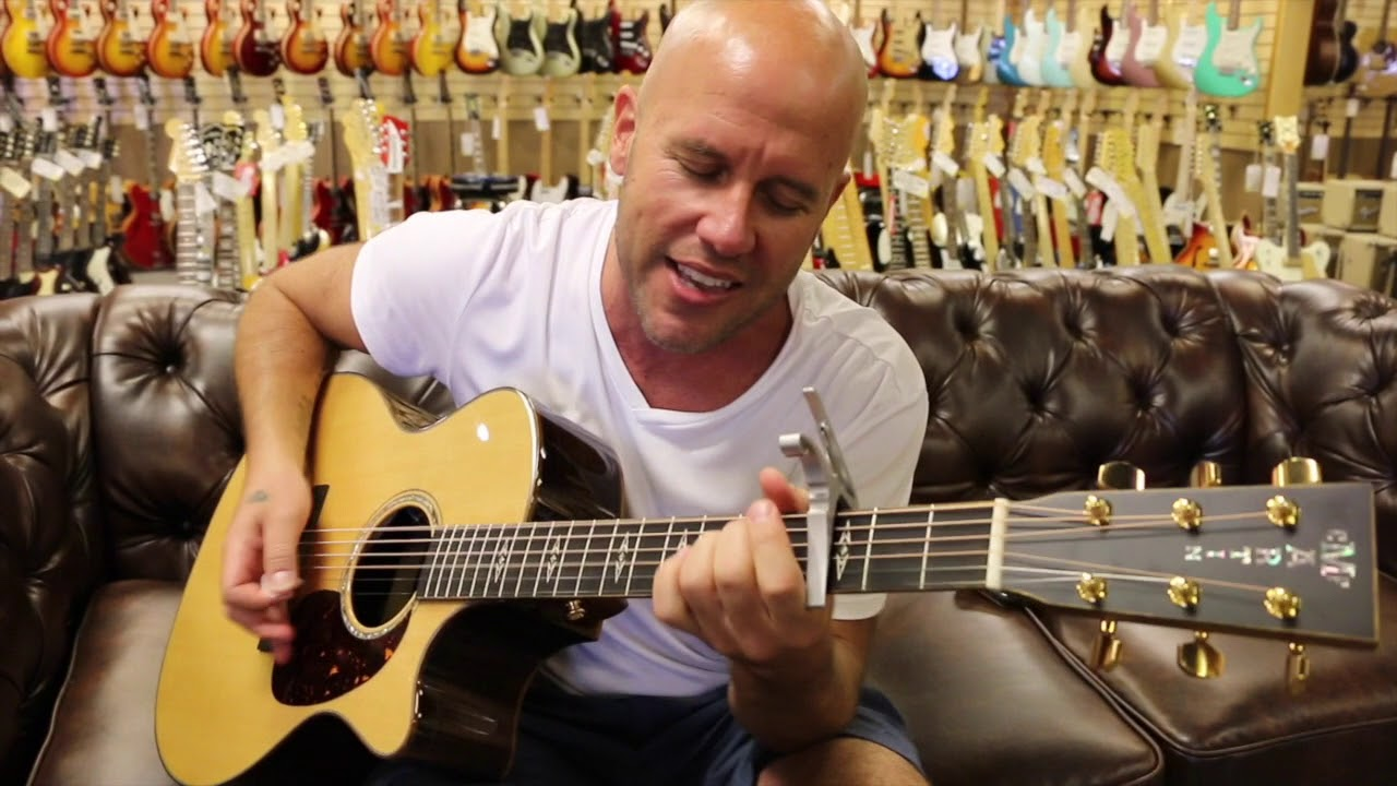 Gian Marco playing a Martin Cutaway Electric/Acoustic at Norman's Rare Guitars