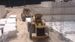 Video Huge Komatsu And Cat Wheel Loaders Working At Marble Quarries MP3, 3GP, MP4, WEBM, AVI, FLV Agustus 2018