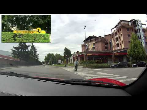 maranello - A drive through Maranello in Italy in a red Ferrari 360 Spider. Starting at Hotel Maranello Village, a hotel and apartments where a lot of Ferrari employees ...