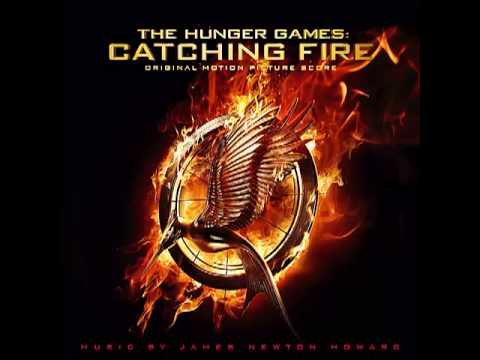 score - Track: 01 Katniss Album: The Hunger Games: Catching Fire (Original Motion Picture Score) By: James Newton Howard 'Katniss' is played in the opening scene whe...