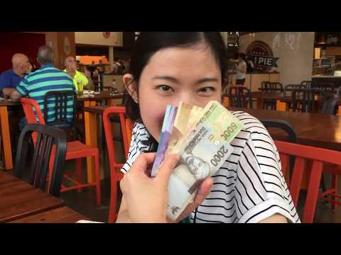 Monica Shows Her Indonesian Currency