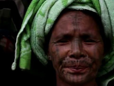 Chin women turn their faces away from painful practice