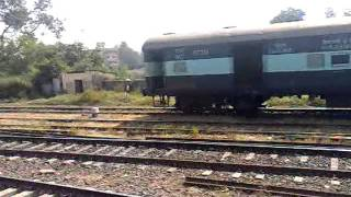 et sta pass leaving jabalpur station and runs parallel with a shunt rake.camera- 5233time 11 pm