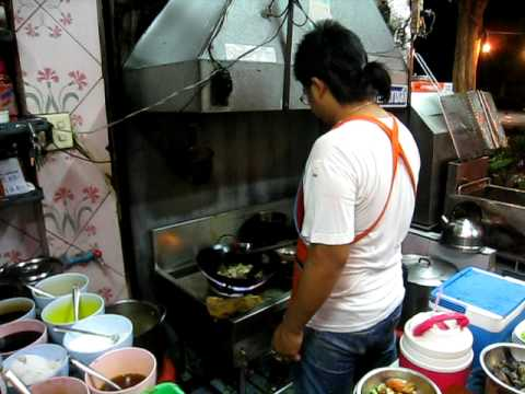 Thai chef performing in one of the best street food restaurants in Bangkok, som tam boo maa.AVI