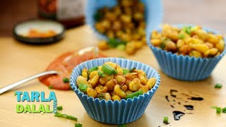 Crispy Fried Corn,Recipe Link : https://www.tarladalal.com/Crispy-Fried-Corn-4132rSubscribe : http://goo.gl/omhUioTarla Dalal App: http://www.tarladalal.com/free-recipe-app.aspxFacebook: http://www.facebook.com/pages/TarlaDalal/207464147348YouTube Channel: http://www.youtube.com/user/TarlaDalalsKitchen/featuredPinterest: http://www.pinterest.com/tarladalal/Google Plus:  https://plus.google.com/107883620848727803776Twitter: https://twitter.com/Tarla_DalalCrispy Fried CornA snack that requires a bit of patience but is so unique and exciting that you will thoroughly enjoy the results of your effort! Unlike most dishes that make use of boiled or crushed sweet corn, here the kernels are deep-fried till absolutely crisp, and then tossed with flavour-givers like ginger, garlic, spring onions and Schezuan sauce to get really scrumptious Crispy Fried Corn. Make sure the boiled corn is dry before mixing with the flours, and once this step is done you should deep-fry it immediately before the mixture gets soggy. When frying the corn, it might splutter a bit, so move away from the kadhai. Preparation Time: 15 minutes.Cooking Time: 15 minutes.Serves 2. 1 cup boiled sweet corn kernels (makai ke dane)2 tbsp plain flour (maida)4 tbsp cornflourSalt and freshly ground black pepper (kalimirch) to tasteOil for deep-frying2 tsp oil2 tsp finely chopped garlic (lehsun)2 tsp finely chopped ginger (adrak)1 tsp finely chopped green chillies1/4 cup finely chopped spring onions (whites and greens)2 tsp Schezuan sauceFor the garnish1 tbsp finely chopped spring onion greensFor servingGreen onion and ginger dipHoney chilli sauce1. Combine the corn, plain flour, cornflour, salt, pepper and 1 tbsp of water in a deep bowl and mix well.2. Heat the oil in a deep non-stick kadhai, and deep-fry the corn in 2 batches till they turn golden brown in colour from all the sides. Drain on an absorbent paper and keep aside.3. Heat the oil in a broad non-stick pan, add the garlic, ginger and green chillies and s